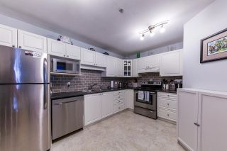 Photo 4: 121 20894 57 Avenue in Langley: Langley City Condo for sale : MLS®# R2302015