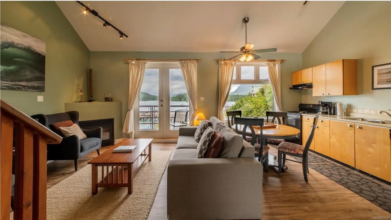 Open concept living room/ dining room with an amazing harbour view
