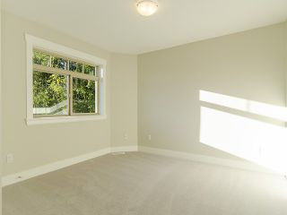 "Photo 14: 3968 ROBIN Place in Port Coquitlam: Oxford Heights House for sale in ""OXFORD HEIGHTS"" : MLS®# V1046329"