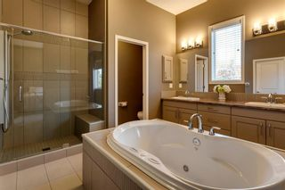 Photo 18: 219 Springbluff Heights SW in Calgary: Springbank Hill Detached for sale : MLS®# A1047010