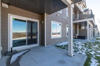 Photo 38: 603 101 SUNSET Drive: Cochrane Row/Townhouse for sale : MLS®# A1031509