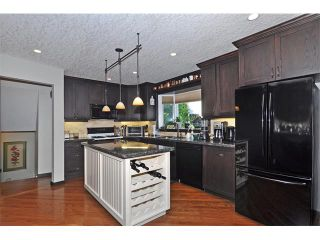 Photo 4: 8 NORSEMAN Place NW in Calgary: North Haven Upper House for sale : MLS®# C4023976