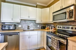 Photo 3: 404 20453 53 Avenue in Langley: Langley City Condo for sale : MLS®# R2186113