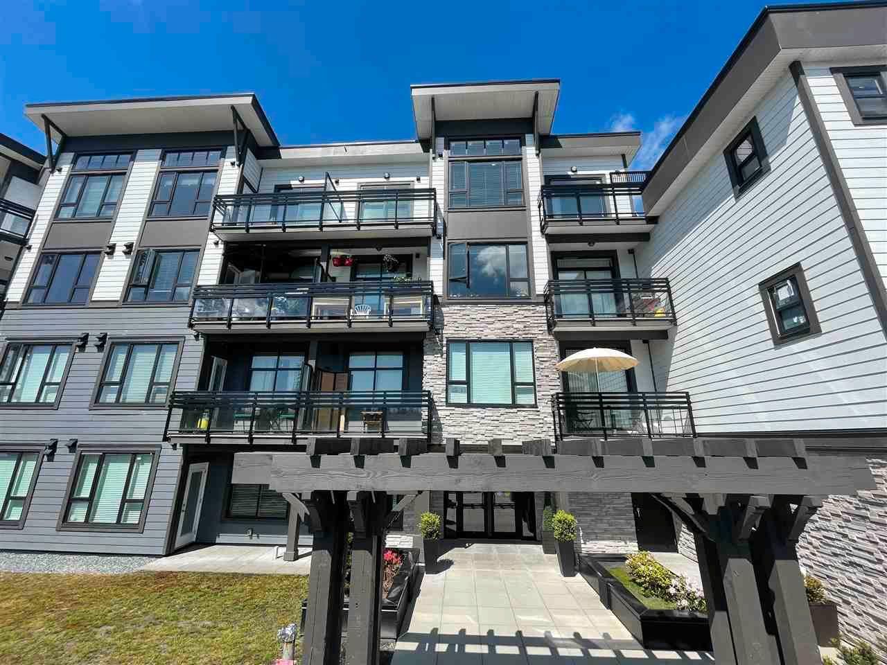 "Main Photo: 404 9983 E BARNSTON Drive in Surrey: Fraser Heights Condo for sale in ""COAST"" (North Surrey)  : MLS®# R2576447"