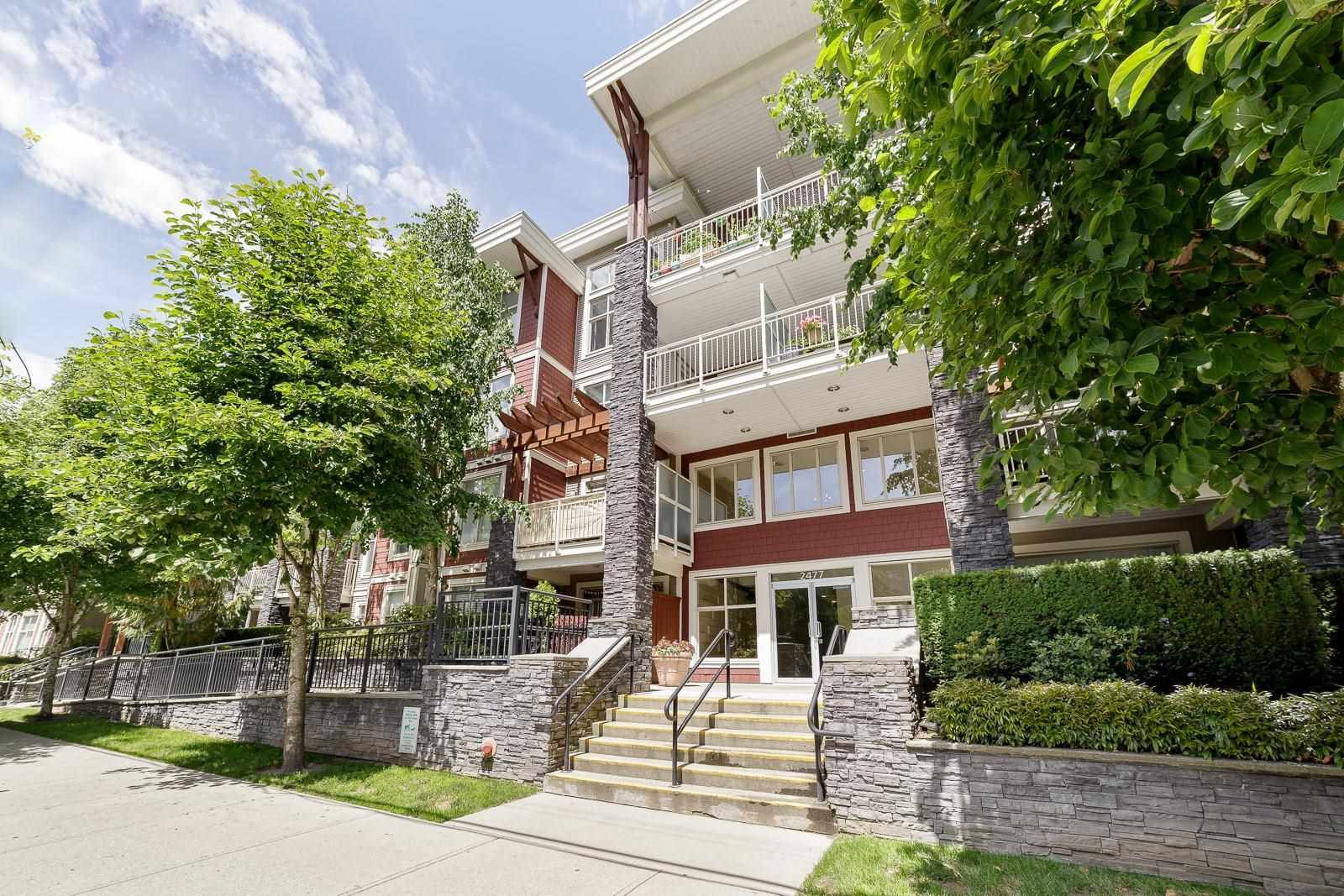 """Main Photo: 214 2477 KELLY Avenue in Port Coquitlam: Central Pt Coquitlam Condo for sale in """"SOUTH VERDE"""" : MLS®# R2595466"""