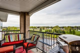 Photo 1: 401 300 Edwards Way NW: Airdrie Apartment for sale : MLS®# A1111826