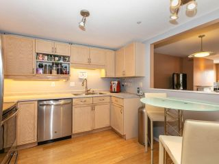 """Photo 8: 215 3400 SE MARINE Drive in Vancouver: Champlain Heights Condo for sale in """"Tiffany Ridge"""" (Vancouver East)  : MLS®# R2392821"""