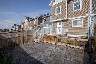 Photo 35: 122 Sunset Road: Cochrane Row/Townhouse for sale : MLS®# A1127717