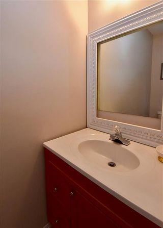 Photo 8: 816 MADEIRA Drive NE in Calgary: Marlborough Park Row/Townhouse for sale : MLS®# C4262604