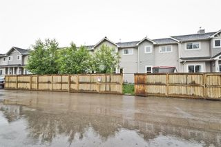 Photo 4: 511 Strathaven Mews: Strathmore Row/Townhouse for sale : MLS®# A1118719