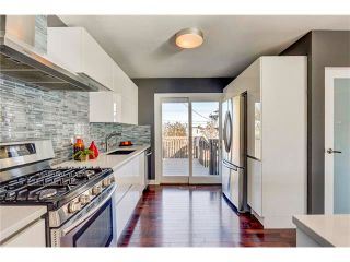Photo 3: 5612 LADBROOKE Drive SW in Calgary: Lakeview House for sale : MLS®# C4036600