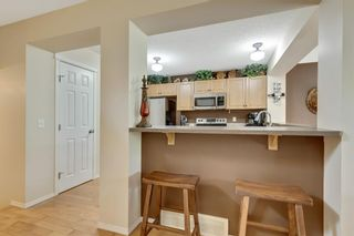 Photo 16: 113 Sunset Heights: Cochrane Detached for sale : MLS®# A1123086