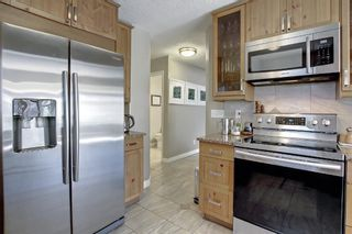 Photo 9: 690 Coventry Drive NE in Calgary: Coventry Hills Detached for sale : MLS®# A1144228