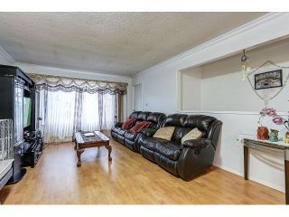 Photo 3: 7541 17TH AVENUE - LISTED BY SUTTON CENTRE REALTY in Burnaby: Edmonds BE 1/2 Duplex for sale (Burnaby East)  : MLS®# R2030562