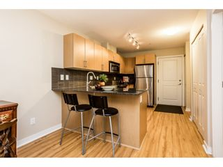 """Photo 9: C101 8929 202 Street in Langley: Walnut Grove Condo for sale in """"THE GROVE"""" : MLS®# R2569001"""