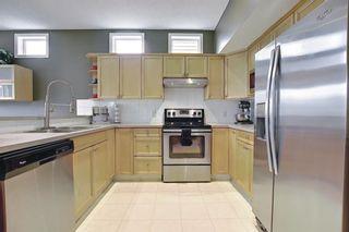 Photo 12: 64 Prestwick Cove SE in Calgary: McKenzie Towne Detached for sale : MLS®# A1118017