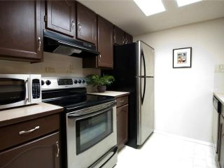 Photo 4: 202 2011 UNIVERSITY Drive NW in CALGARY: C-416 Condo for sale (Calgary)  : MLS®# C3484383