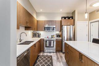 Photo 3: 202 10 Auburn Bay Link SE in Calgary: Auburn Bay Apartment for sale : MLS®# A1128841