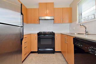 "Photo 5: 305 500 KLAHANIE Drive in Port Moody: Port Moody Centre Condo for sale in ""KLAHANIE"" : MLS®# R2071746"