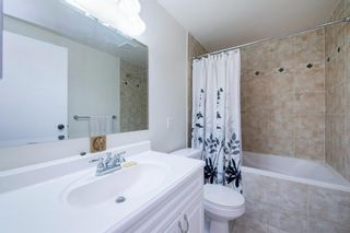 Photo 37: 332 Queenston Heights SE in Calgary: Queensland Row/Townhouse for sale : MLS®# A1114442