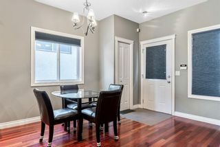 Photo 9: 702 69 Avenue SW in Calgary: Kingsland Semi Detached for sale : MLS®# A1081661
