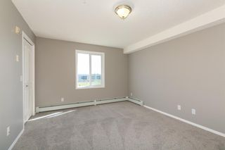Photo 14: 8329 304 MACKENZIE Way SW: Airdrie Apartment for sale : MLS®# A1128736