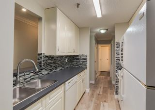 Photo 8: 110 727 56 Avenue SW in Calgary: Windsor Park Apartment for sale : MLS®# A1133912