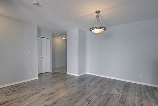 Photo 14: 7402 304 MacKenzie Way SW: Airdrie Apartment for sale : MLS®# A1081028