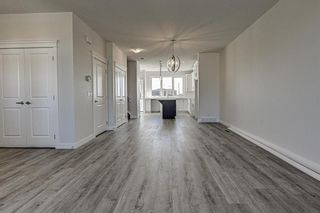 Photo 4: 132 Creekside Drive SW in Calgary: C-168 Semi Detached for sale : MLS®# A1098272