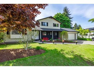 """Photo 1: 5693 246B Street in Langley: Salmon River House for sale in """"Strawberry Hills"""" : MLS®# R2581295"""