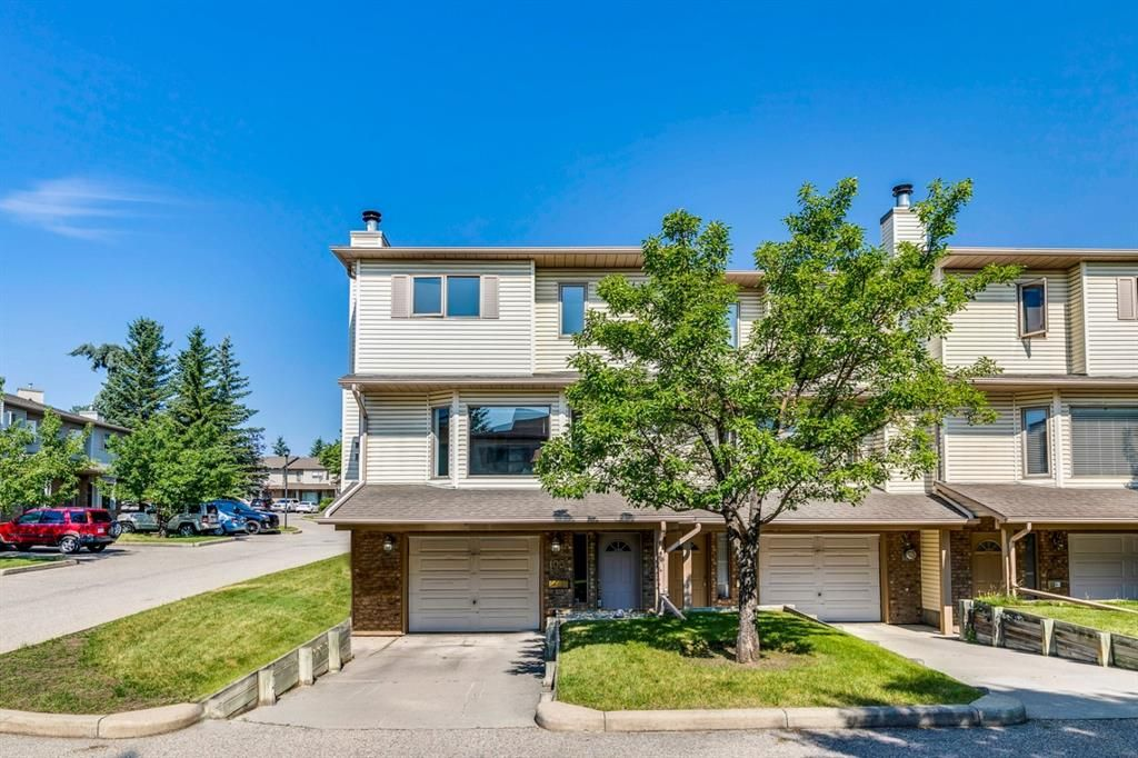 Main Photo: 100 Patina Park SW in Calgary: Patterson Row/Townhouse for sale : MLS®# A1130251