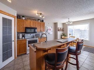 Photo 4: 154 New Brighton Circle SE in Calgary: New Brighton Detached for sale : MLS®# A1073444