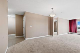 Photo 15: 7411 403 Mackenzie Way SW: Airdrie Apartment for sale : MLS®# A1152134