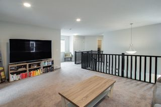 Photo 16: 224 Crestmont Drive SW in Calgary: Crestmont Detached for sale : MLS®# A1118392