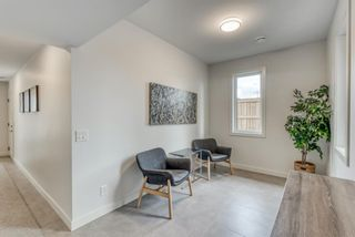 Photo 4: 98 23 Street NW in Calgary: West Hillhurst Row/Townhouse for sale : MLS®# A1066637