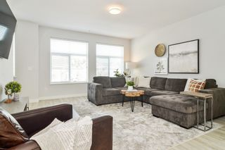 """Photo 3: 44 8371 202B Street in Langley: Willoughby Heights Townhouse for sale in """"Kensington Lofts"""" : MLS®# R2606298"""