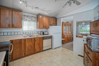 """Photo 13: 102 2303 CRANLEY Drive in Surrey: King George Corridor Manufactured Home for sale in """"SUNNYSIDE ESTATES"""" (South Surrey White Rock)  : MLS®# R2618060"""