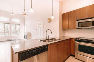 """Photo 4: 407 225 FRANCIS Way in New Westminster: Fraserview NW Condo for sale in """"THE WHITTAKER"""" : MLS®# R2621652"""