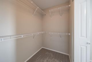 Photo 35: 404 720 Willowbrook Road NW: Airdrie Row/Townhouse for sale : MLS®# A1098346