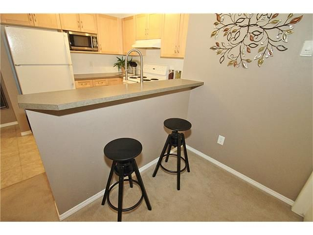 Photo 14: Photos: 4210 70 PANAMOUNT Drive NW in Calgary: Panorama Hills Condo for sale : MLS®# C4076260