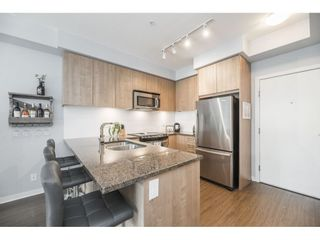 """Photo 7: 102 6460 194 Street in Surrey: Clayton Condo for sale in """"Water Stone"""" (Cloverdale)  : MLS®# R2572204"""