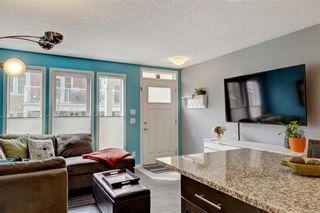 Photo 8: 167 AUBURN MEADOWS Walk SE in Calgary: Auburn Bay Row/Townhouse for sale : MLS®# C4244093
