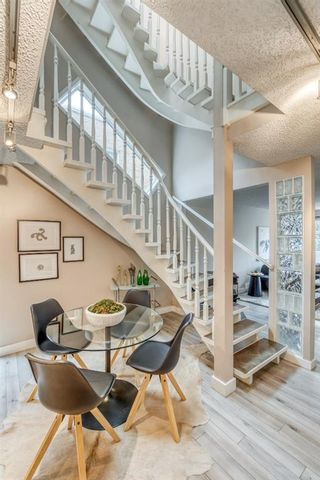 Photo 1: 7 2440 14 Street SW in Calgary: Upper Mount Royal Row/Townhouse for sale : MLS®# A1093571