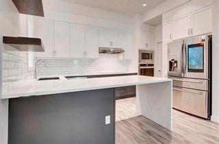 Photo 3: 2 139 24 Avenue NE in Calgary: Tuxedo Park Row/Townhouse for sale : MLS®# A1064305