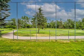 Photo 49: 34 Woodmeadow Close SW in Calgary: Woodlands Semi Detached for sale : MLS®# A1127227