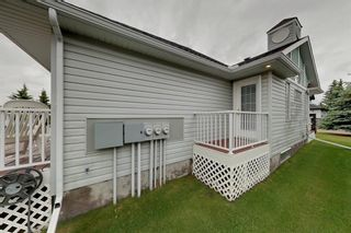 Photo 3: 38 1008 Woodside Way NW: Airdrie Row/Townhouse for sale : MLS®# A1123458