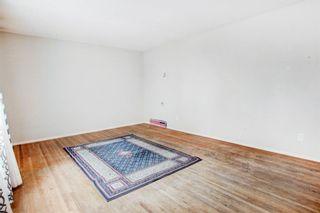 Photo 4: 411 Goddard Avenue NE in Calgary: Greenview Row/Townhouse for sale : MLS®# A1119433