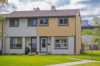 Photo 1: 98 2720 Rundleson Road NE in Calgary: Rundle Row/Townhouse for sale : MLS®# A1075700
