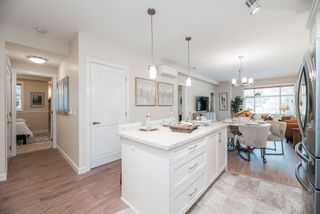 Photo 2: 301 20328 86 Avenue in Langley: Willoughby Heights Condo for sale : MLS®# R2603617