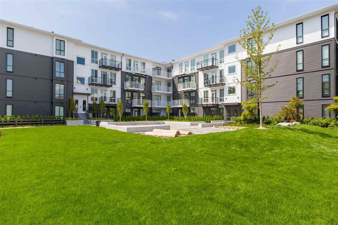 Main Photo: 202 10168 149 Street in Surrey: Guildford Condo for sale (North Surrey)  : MLS®# R2389741